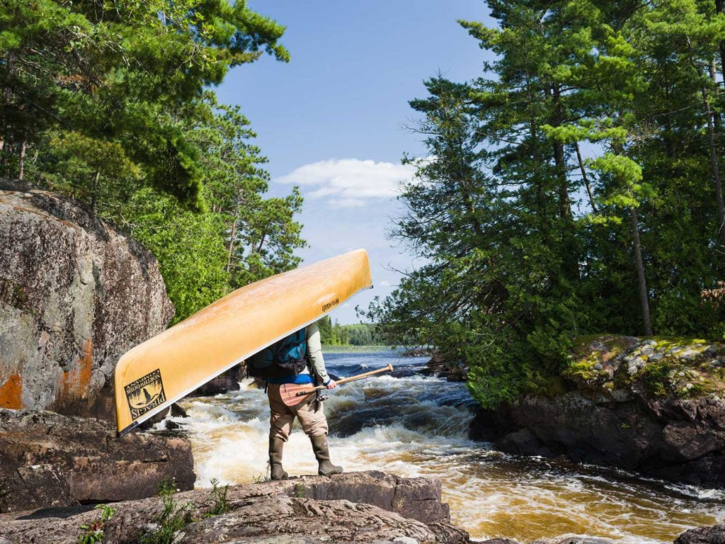 Guide Tim Barton Portaging a Canoe from Piragis Northwoods Company
